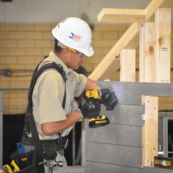 Construction Worker building a small shed